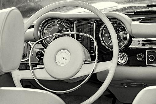 Hamburg, Germany - November 01. 2019: Vintage dashboard of german Mercedes 280 SL cabriolet